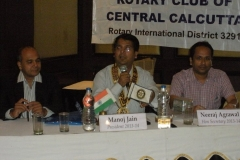 Presiding over Rotary Club meeting