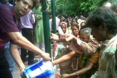 Rice Distribution in flood effected area at Bandherhati, Hoogly - August 2011